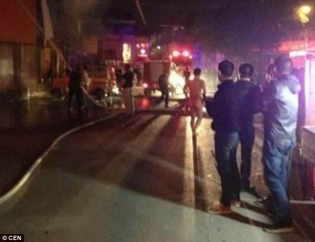 Naked bathers flee fire In China