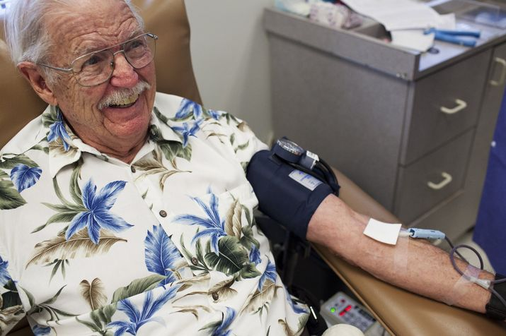 Harold Mendenhall, 84, talks and smiles at one of the nurses while donating blood at One Blood in Lake Park on May 22. Mendenhall is known and loved at the center, and has donated more than 100 gallons of blood, both whole and platelets. (Laura McDermott/The Palm Beach Post)