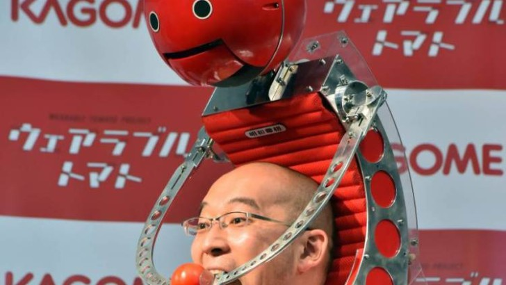 Tomato robot:  Robot Sits On Your Shoulders Feeding You Tomatoes