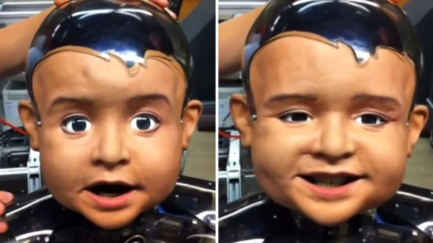 Study shows why babies smile: Creepy robot shows why babies smile (VIDEO)