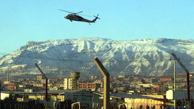 A Sikorsky helicopter of the Turkish army, reportedly carrying supplies to the Turkey-Iraq border, flies over border town of Silopi, 15 km (9 miles) from the border, in southeastern Turkey, on Dec. 27, 2002. (Associated Press)