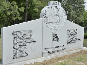 The World War II monument at Veterans Park in Albany was defaced most likely Friday night by vandals with black spray paint. Albany police responded to the scene Saturday around 3 p.m. (Staff photo: Jim West)